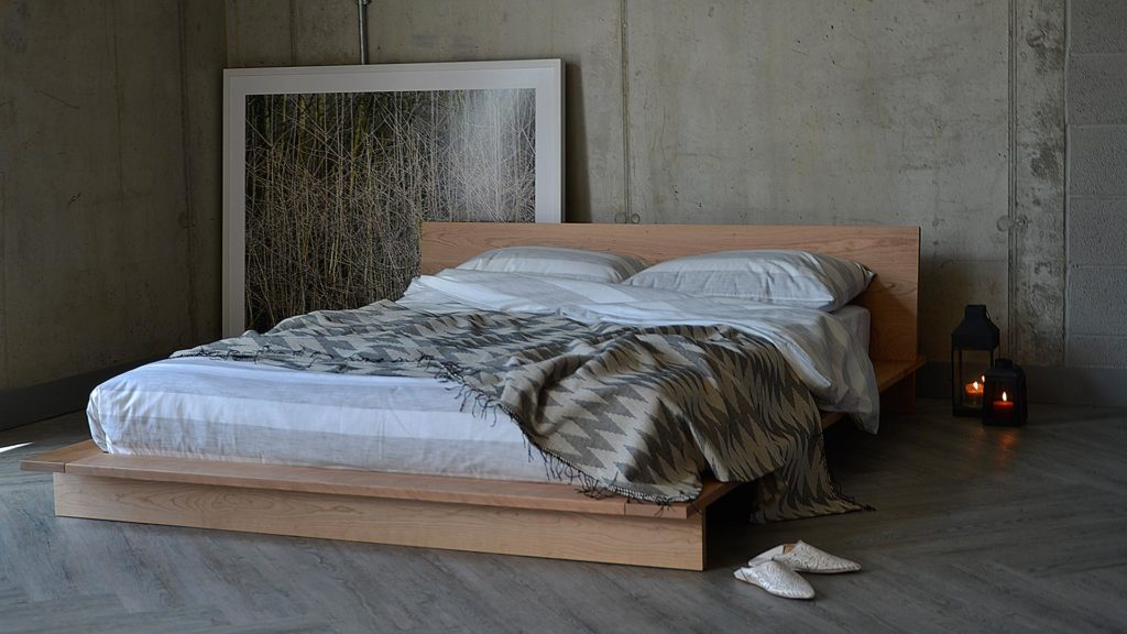 striped cotton bedding on our low hand-made solid wood Platform Oregon bed shown in Cherry