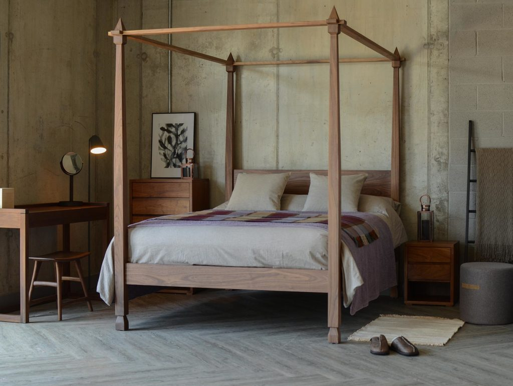 A contemporary Indian look bed, the Raj 4 Poster made in Britain from solid wood.