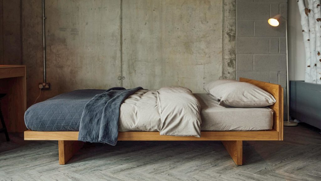 Side view of our Kyoto bed in Oak. Available to order in a choice of solid wood and a range of sizes.