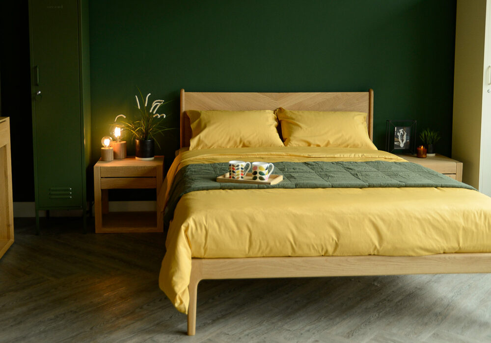 colourful bedrooms forest green wall and mustard yellow bamboo fibre bedding