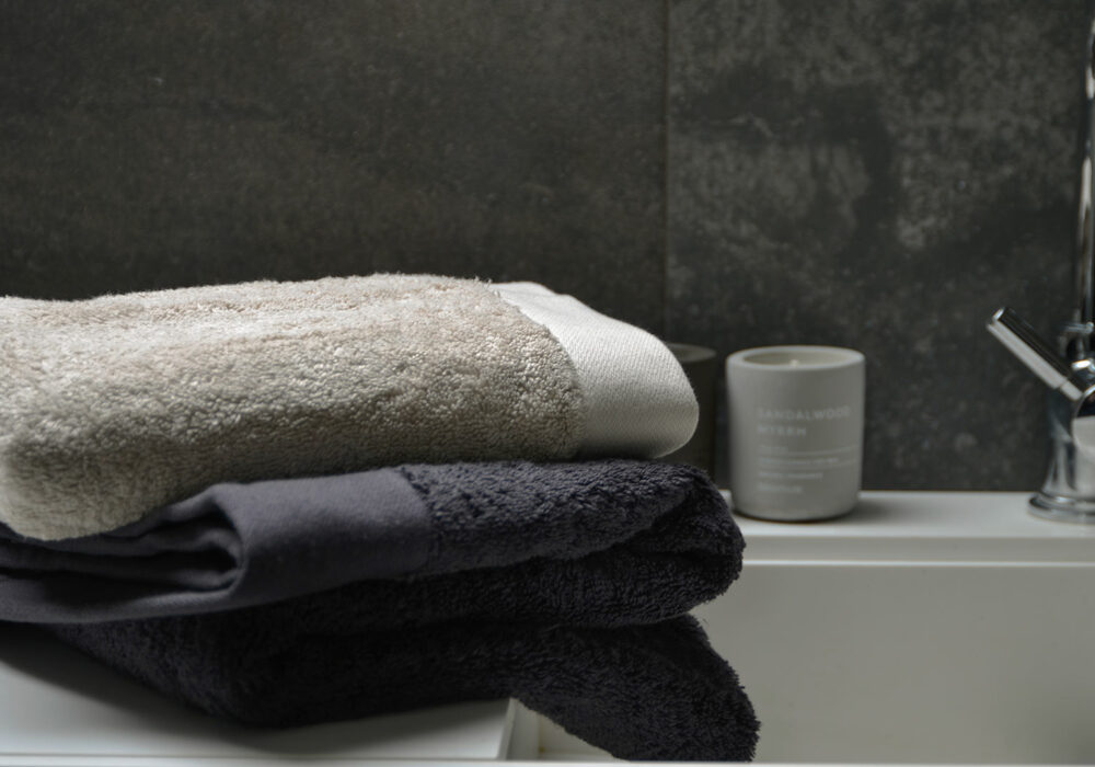 GOTS certified organic cotton towels in dark grey or pale clay
