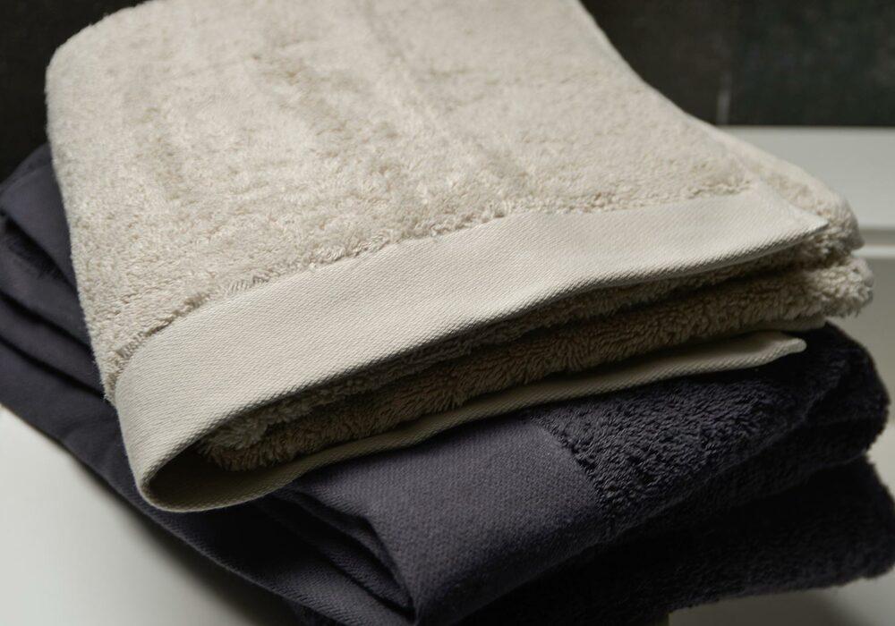 organic cotton bathroom towels in dark grey or pale clay