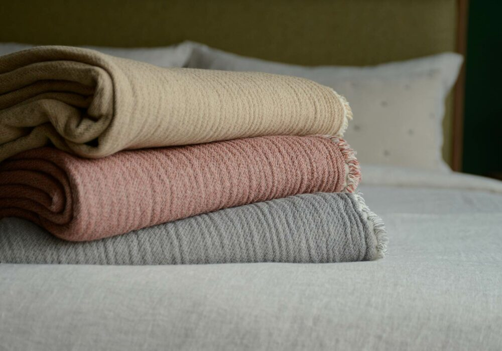 organic cotton reversible throws in 3 colour options