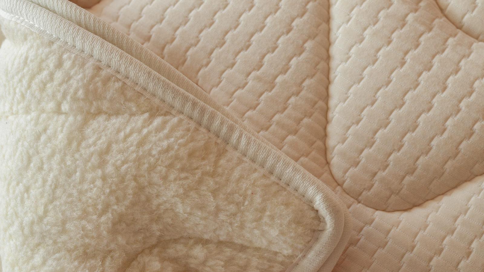 Reversible organic cotton & wool mattress topper