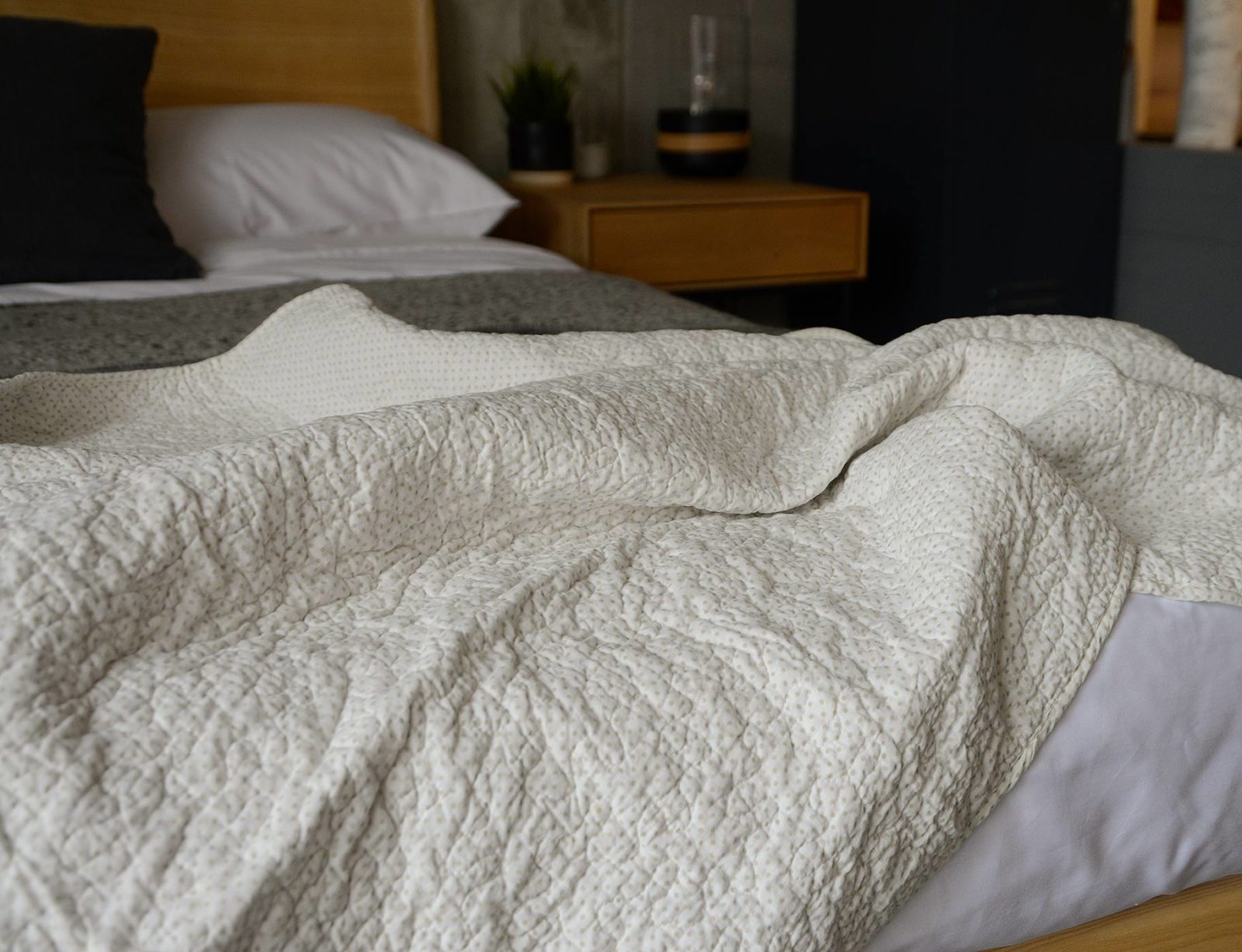 pale cotton quilted throw