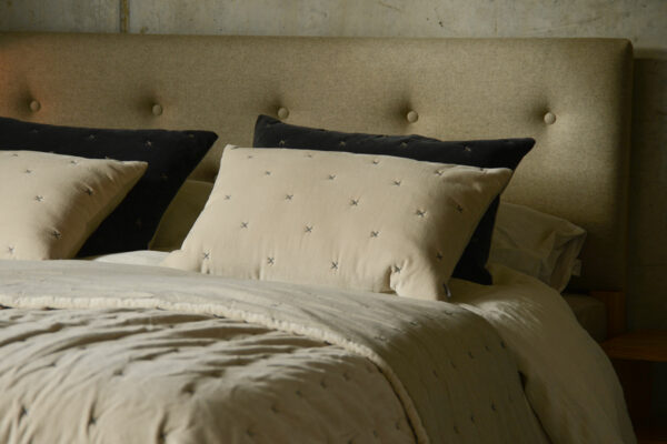velvet cushion covers and bedspread with stitch detailing