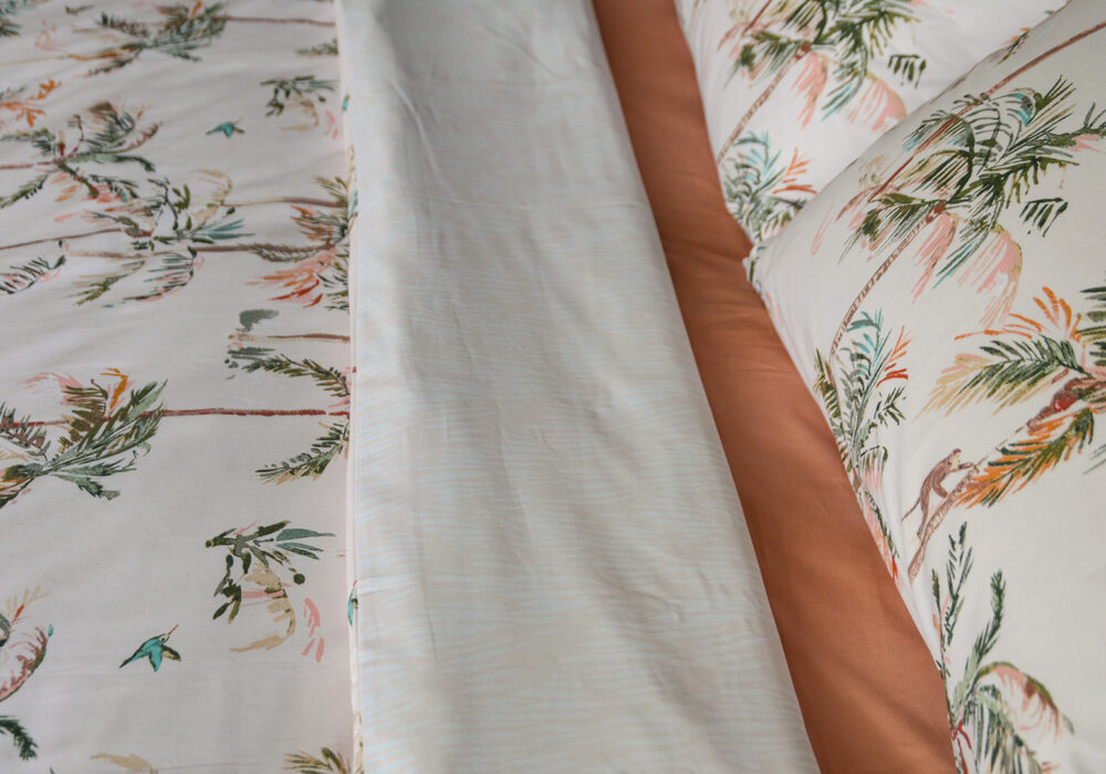 reversible blush pink duvet cover set with tropical palms print a closer view
