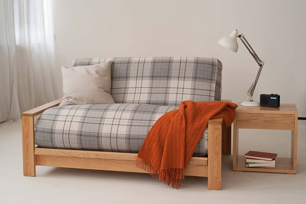Panama Oak framed futon sofa bed, the futon has a check loose cover in wool