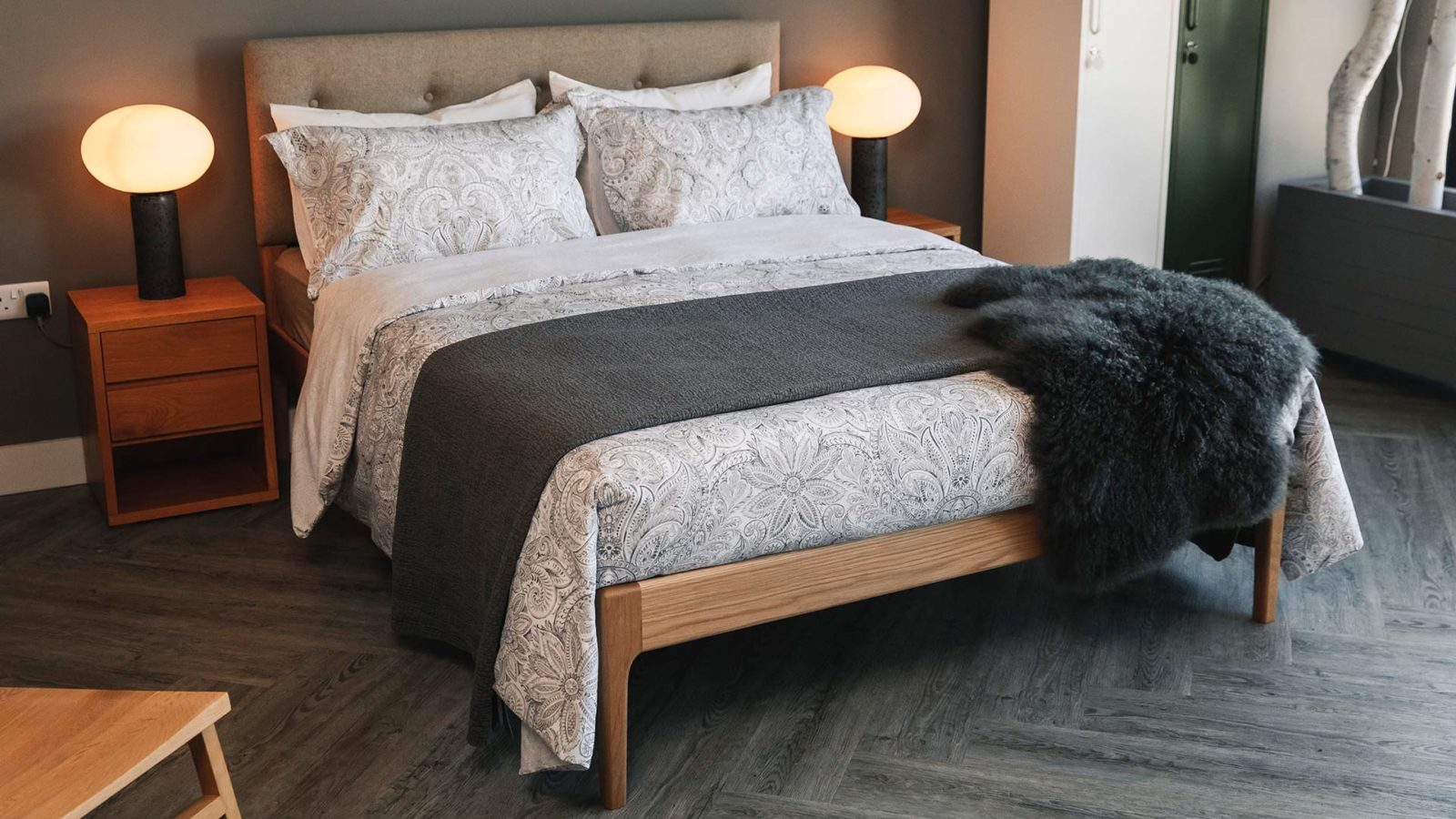 crisp white and grey print duvet set shown with a dark grey bedspread