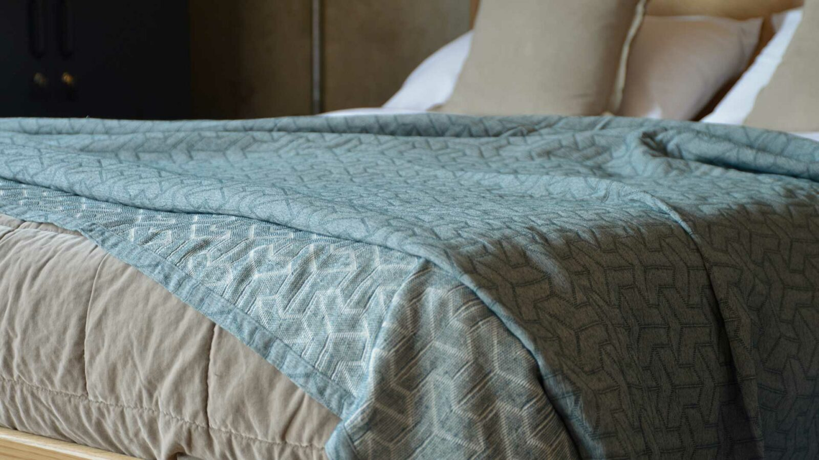 petrol blue recycled cotton bedspread with stitched geometric pattern