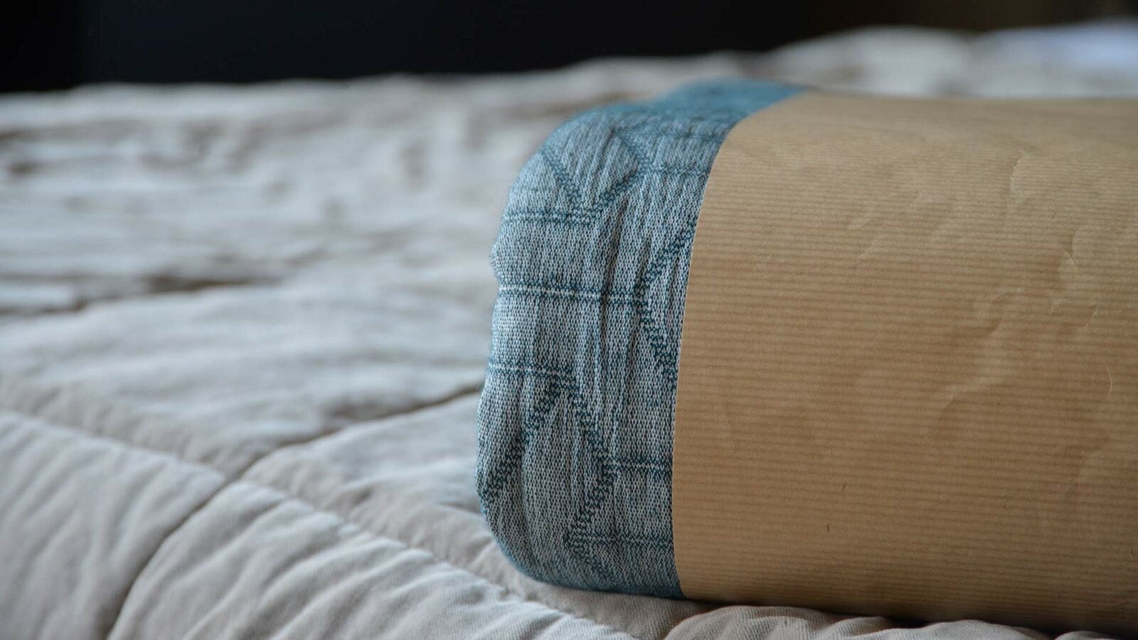 petrol blue recycled cotton bedspread shown packaged