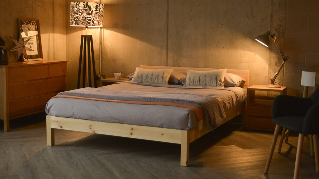 Cosy loft style bedroom featuring our pine sahara-nevada mix bed made from Pine