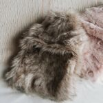 pink coloured faux-fur covered hot water bottles