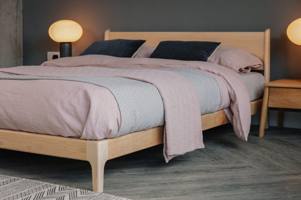 Blush pink bedding on low Pimlico bed