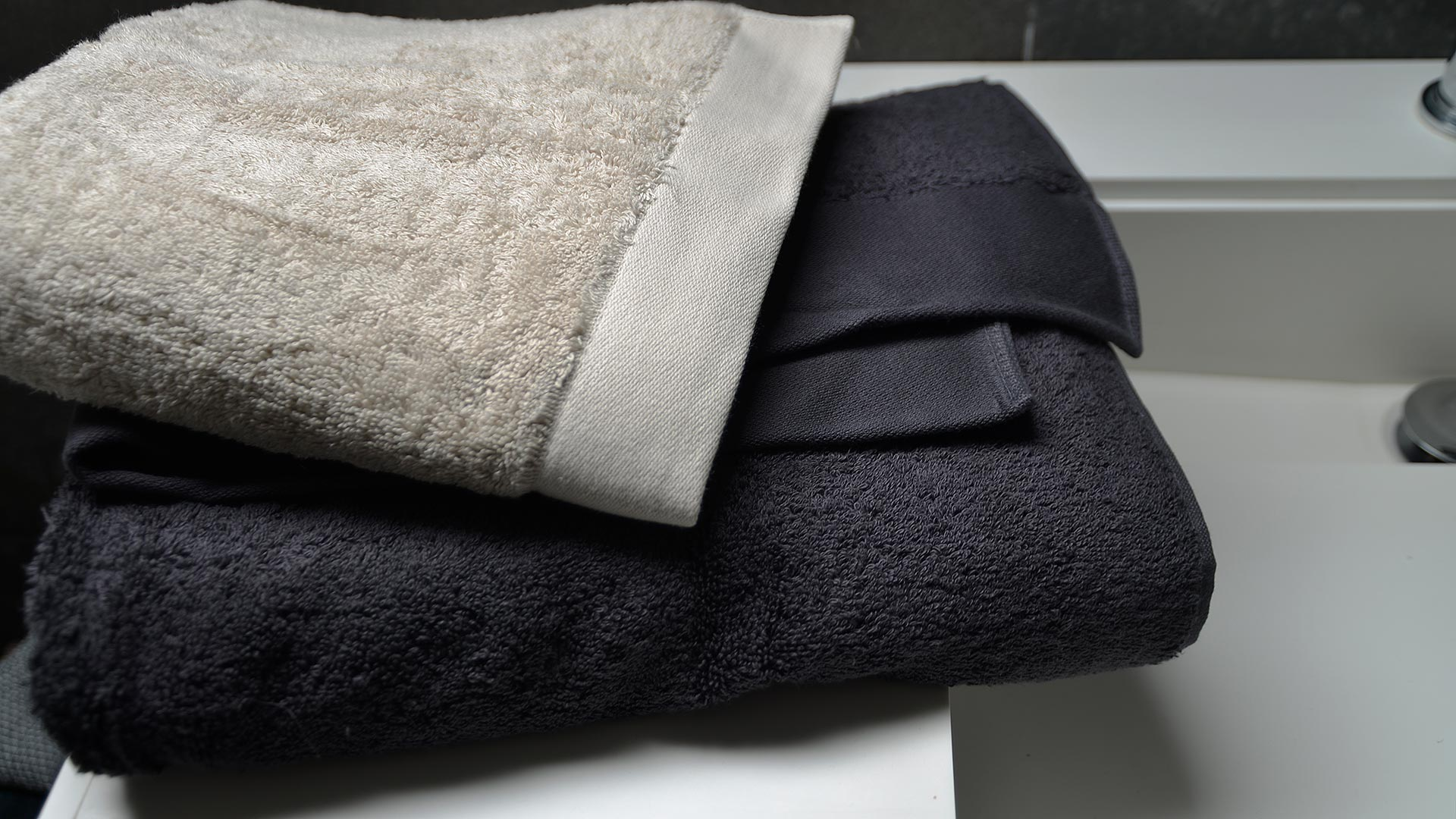 organic cotton towels in dark grey or pale clay