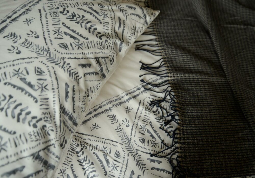a close up view of the Riad design printed polycotton duvet set