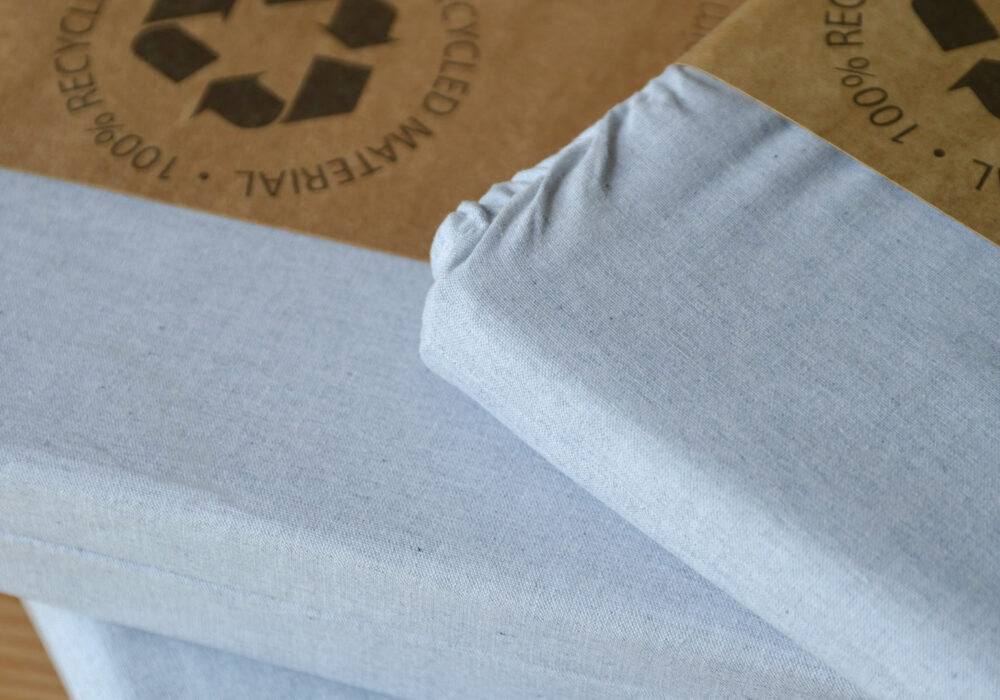 pale blue recycled denim bedding a close-up view