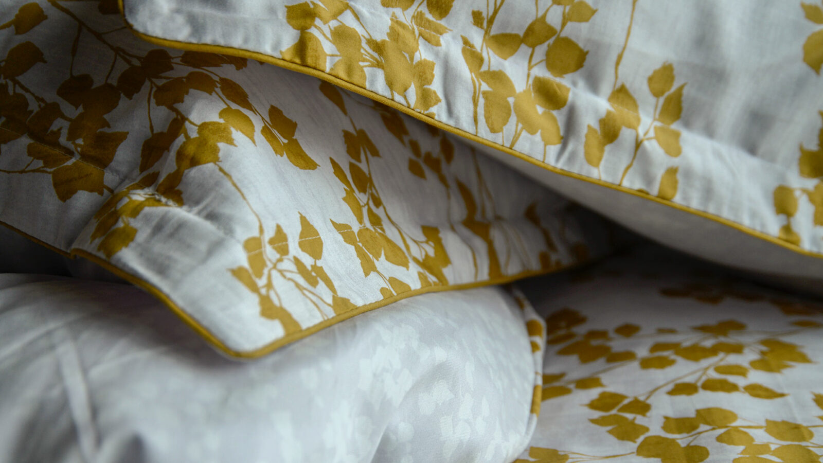 reversible leaf print duvet cover set in mustard yellow and white a close up view