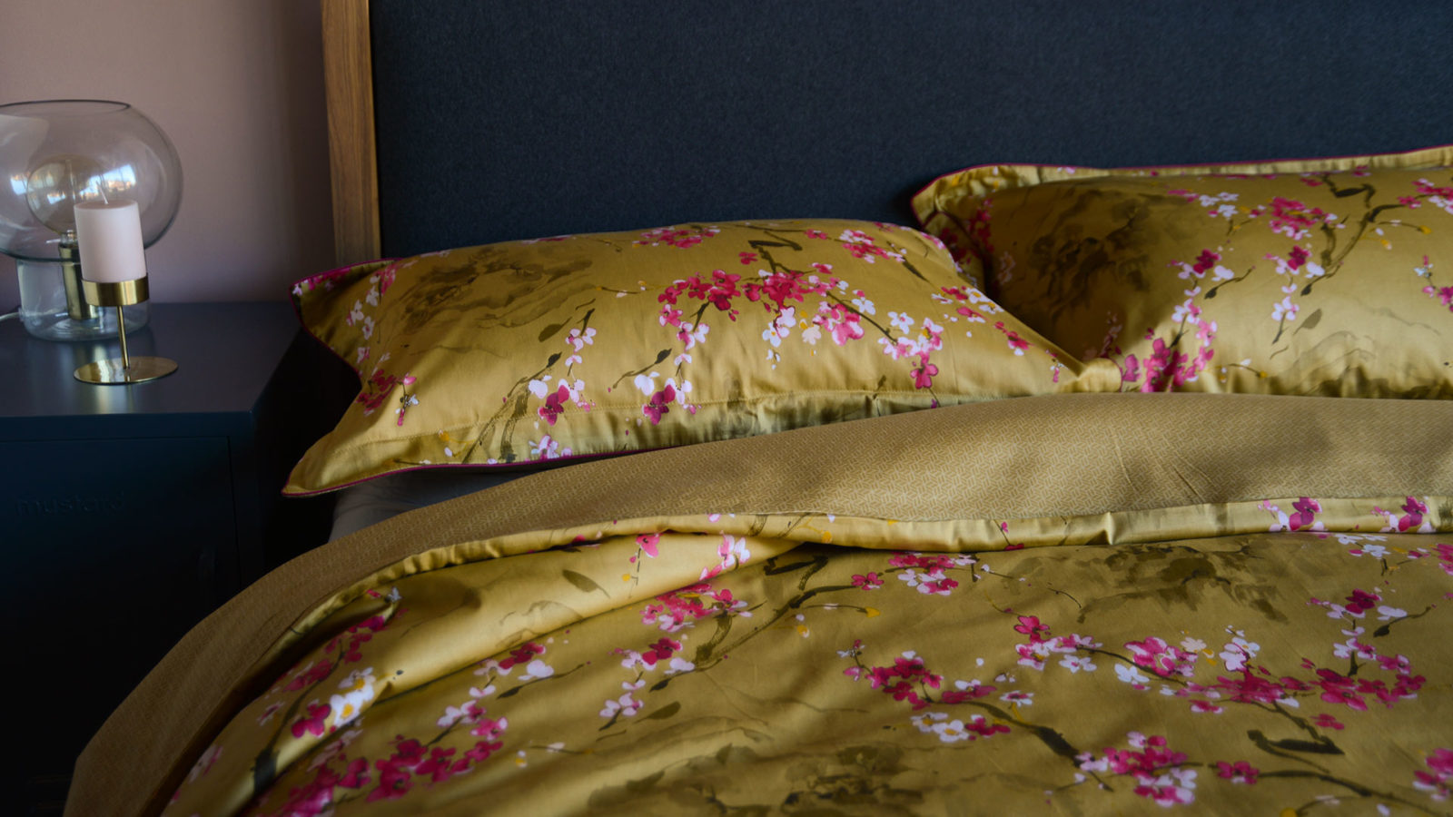 gold and pink cherry blossom print bedding