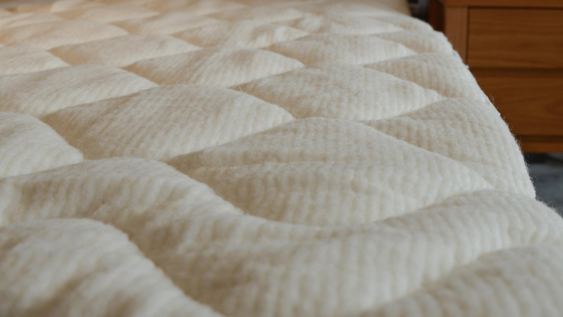 reversible coolmax mattress topper - wool side