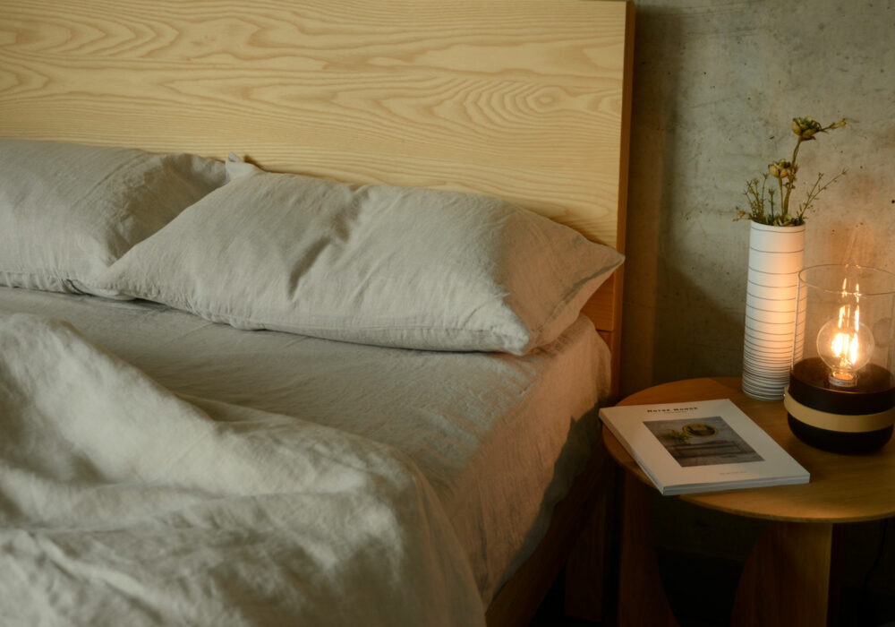 relaxed look bed with 100% linen bedding in a Beige marl colour