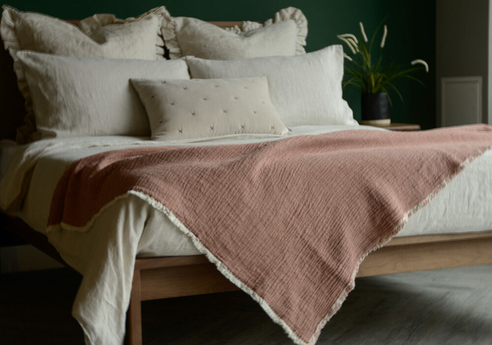 organic cotton reversible throw in blush pink and ivory