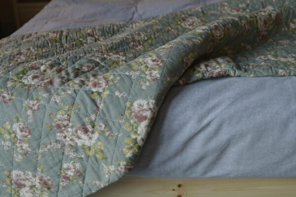 sage-green-and-rose-print-quilted-throw