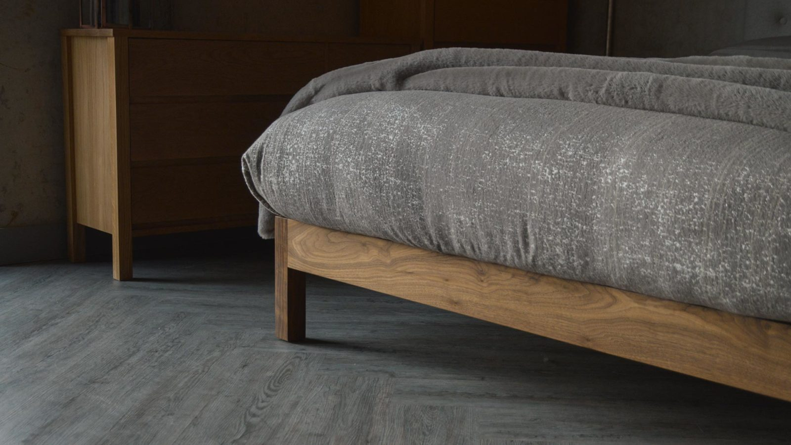 A closer view of the Arran bed walnut leg and foot end bed frame