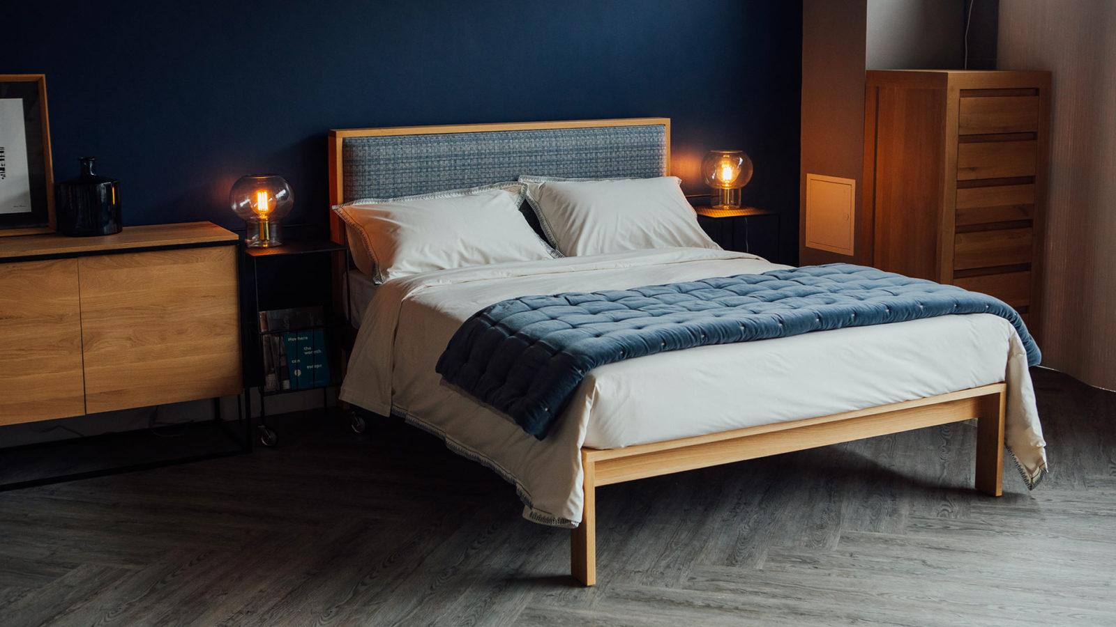Blue bedroom with Kingsize Shetland Wooden bed in Oak with padded headboard