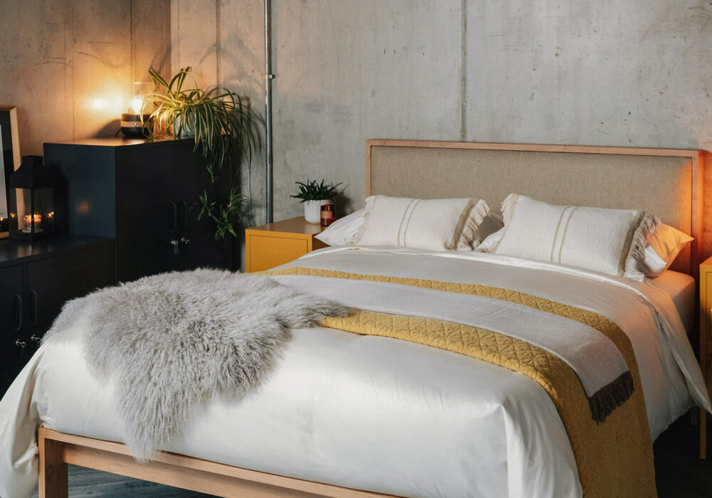 Organic cotton bedding in finest sateen shown on our Shetland wooden bed with padded headboard