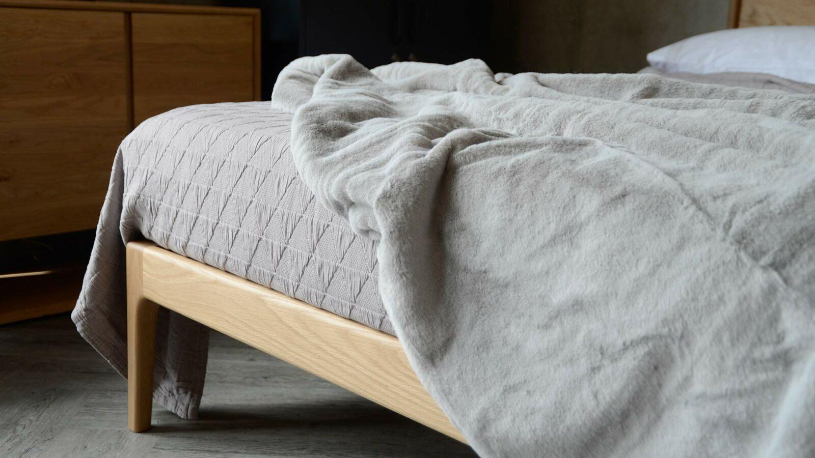 Silver grey faux fur bedspread