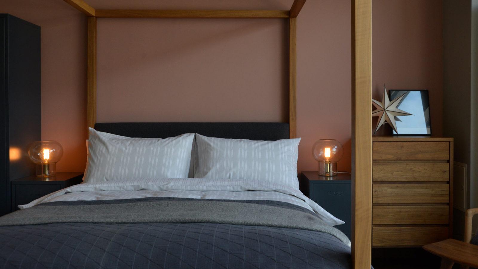 Ikat stripe printed duvet set on our solid wood Highland 4 poster bed
