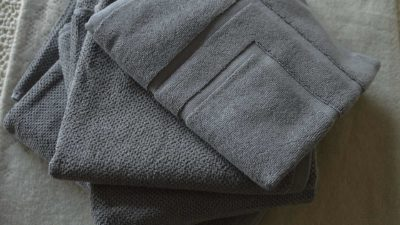 grey-textured-towels with bath mat