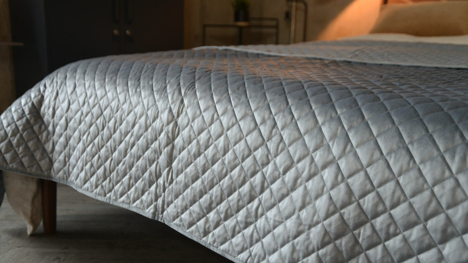 silver grey velvet-look quilted and reversible bedspread a closer view