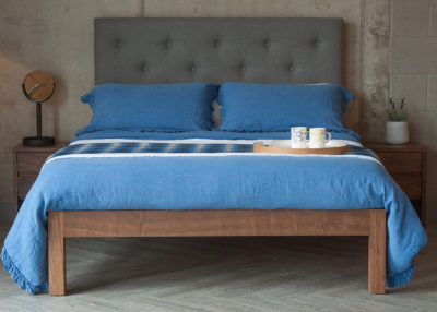Skye a Classic solid wood bed frame with a tall upholstered and buttoned headboard