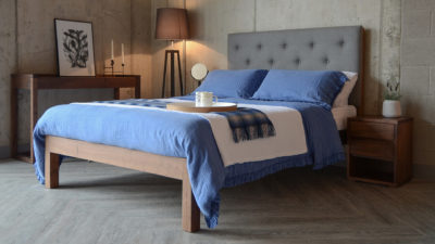 skye bed with blue linen bedding and walnut furniture
