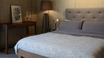 skye bed with grey linen bedding and broste organic cotton throw