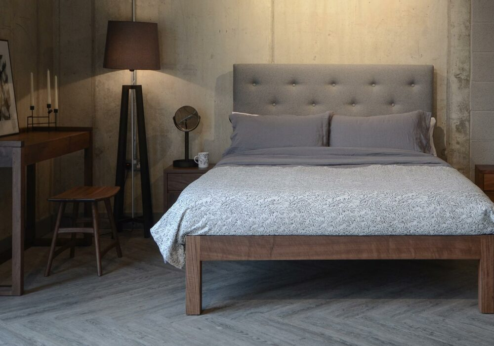 Loft style bedroom with walnut wood Skye tall buttoned headboard bed and walnut bedroom furniture