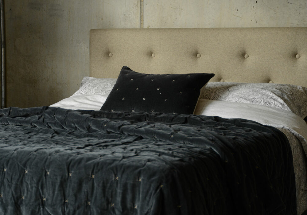 velvet bedspread and matching cushion cover with stitch detail