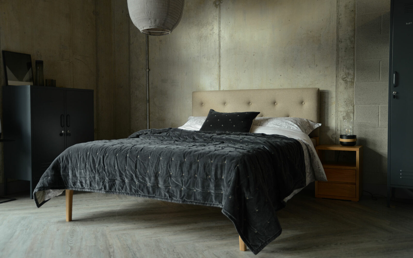 contemporary oak bed with upholstered headboard with velvet bedspread