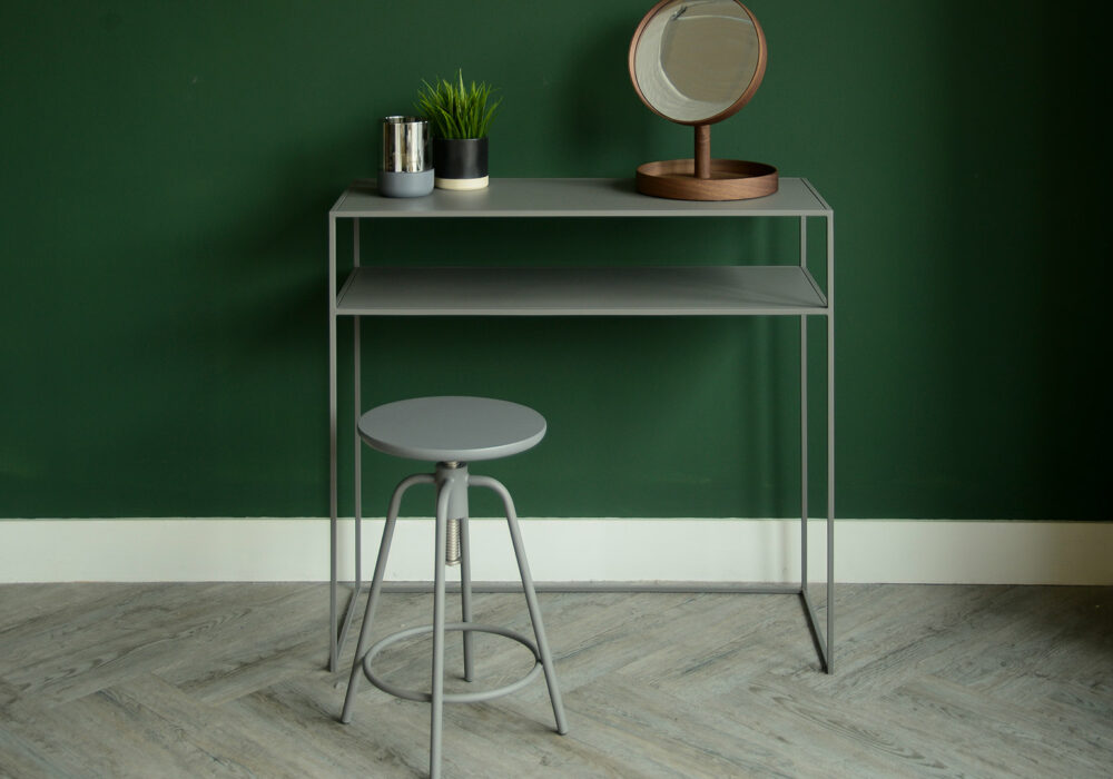 metal console table with shelf in warm grey shown with matching adjustable stool