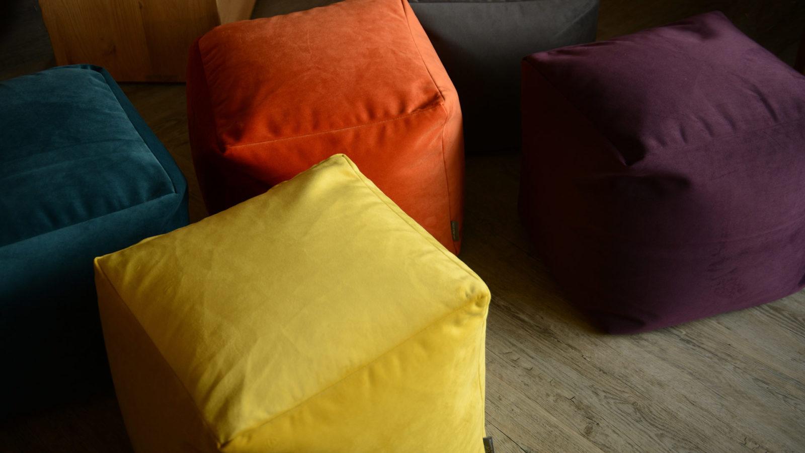 soft cube shaped velvet pouffs in a range of jewel colours
