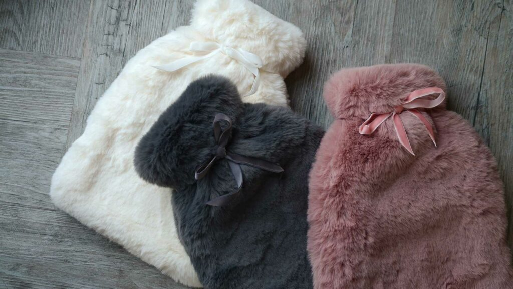 Soft and cosy faux fur hot water bottles in 3 colours