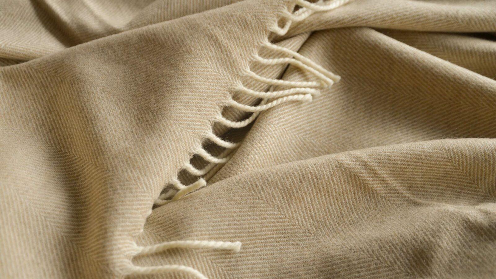 soft merino wool herringbone weave blanket in beige and ivory