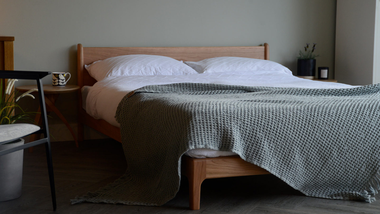 contemporary country bedroom look - solid cherry low wooden Pimlico bed and sage throw