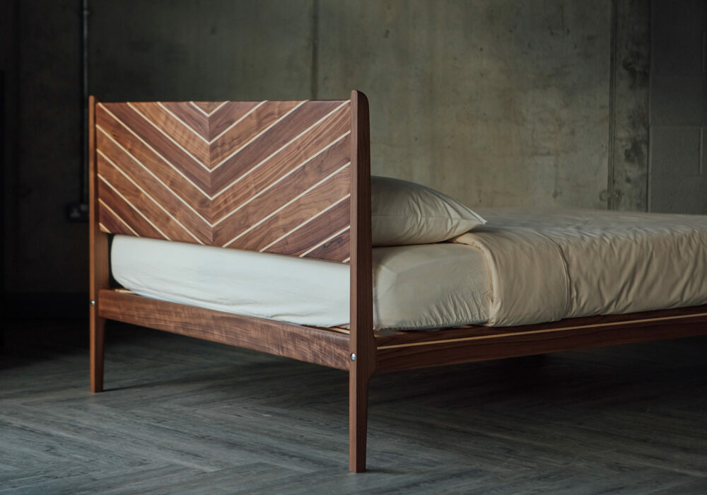 Photo showing the reverse of the handmade Special edition Hoxton bed headboard in walnut and maple