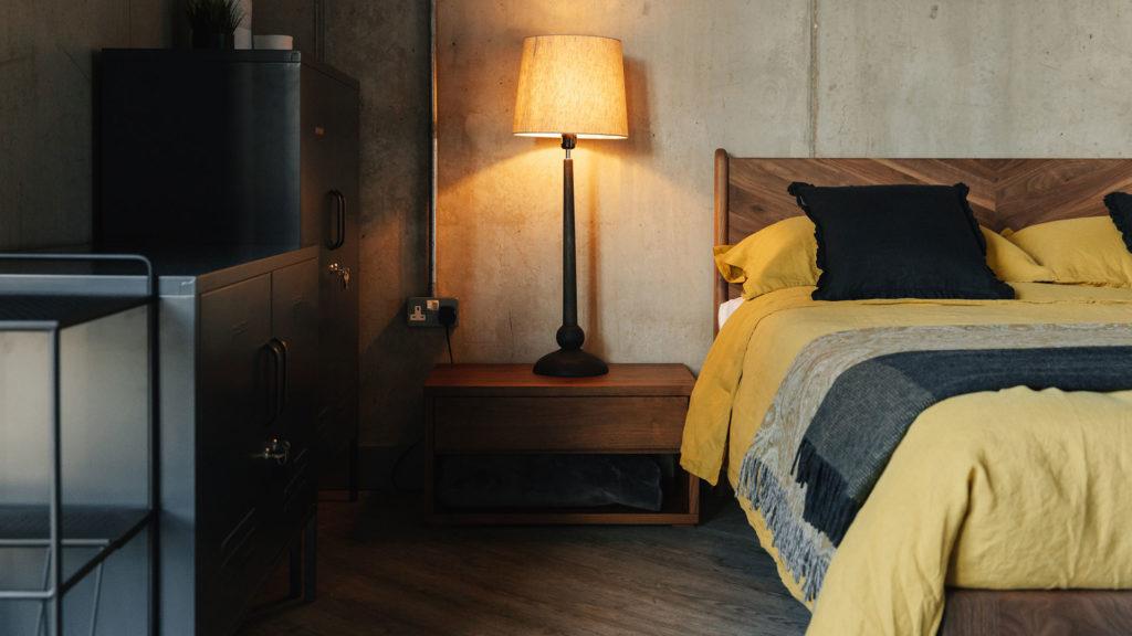 tall, dark wooden lamp base