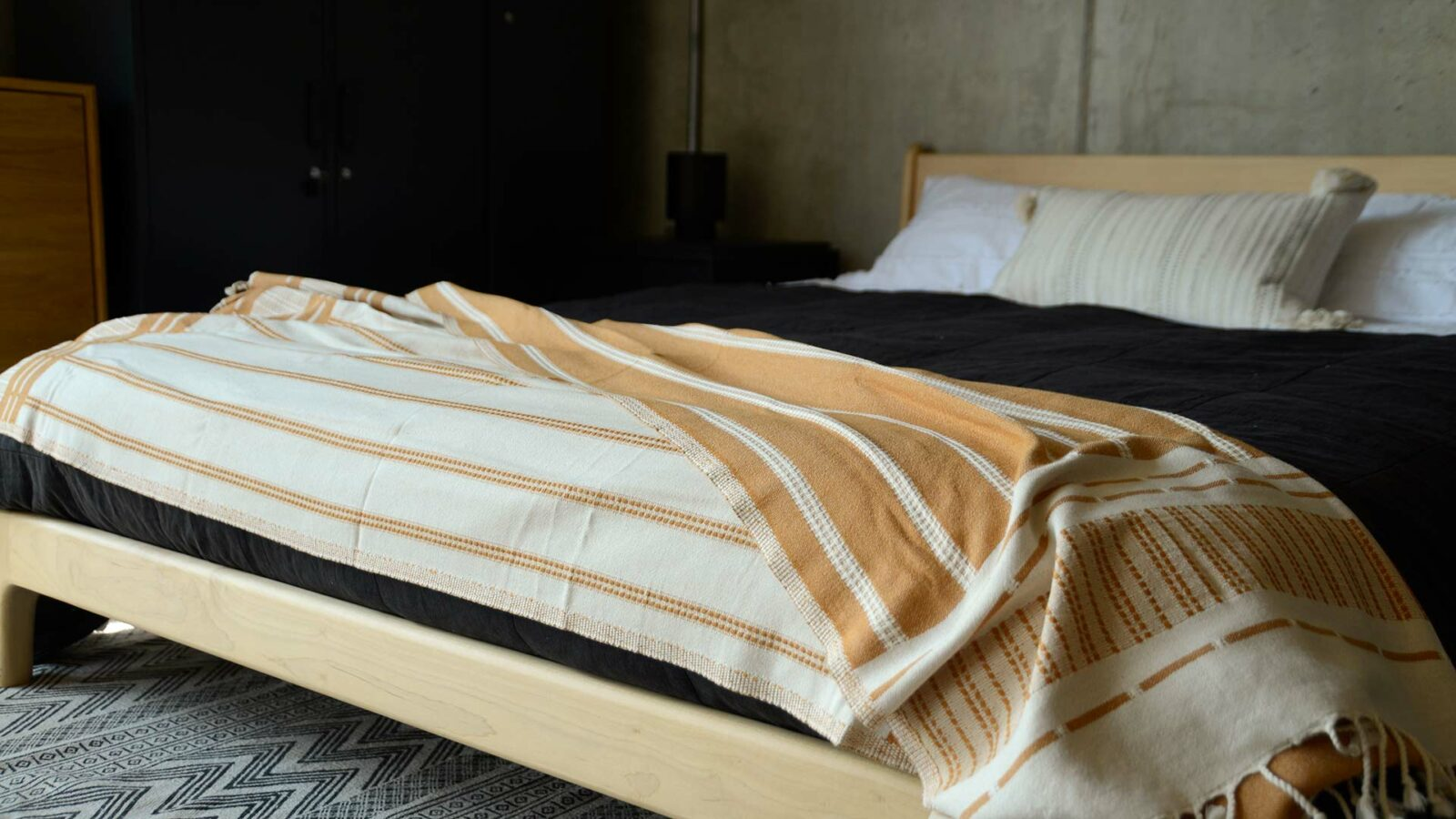 reversible tan and ivory colour woven cotton throw