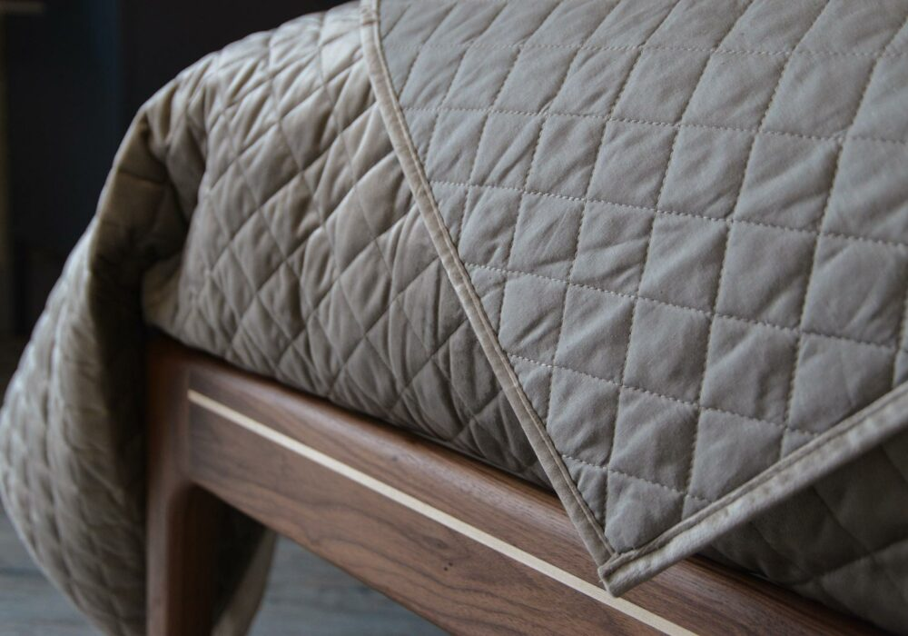 Taupe coloured velvet-look quilted and reversible bedspread a closer view
