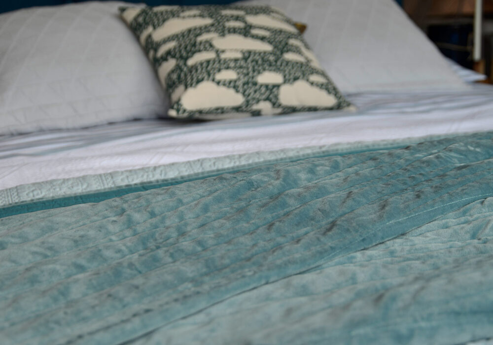 Harlquin embroidered bedspread in teal